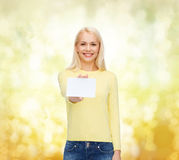Smiling girl with blank business or name card Royalty Free Stock Photos