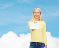 Smiling girl with blank business or name card Royalty Free Stock Photo