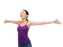 Smiling girl in blank purple tank top waving hands Royalty Free Stock Photos