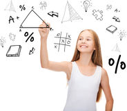 Smiling girl in blank white shirt drawing triangle. Education and new technology concept - smiling teenage girl in blank white shirt drawing triangle on virtual Stock Image