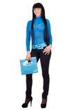 Smiling girl with a blue handbag Royalty Free Stock Image