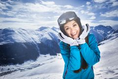 Smiling girl blue jacket alps mountain resort Stock Photo