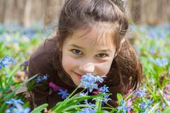 Smiling girl among the bluebells Royalty Free Stock Image