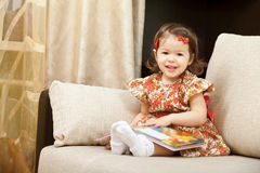 Smiling girl with book Royalty Free Stock Photo