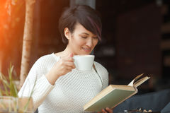 Smiling girl with book and cup royalty free stock photo