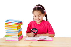 Smiling girl with books and magnifier Royalty Free Stock Images