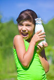 Smiling girl with bottle of milk Stock Photos