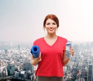 Smiling girl with bottle of water after exercising Stock Images