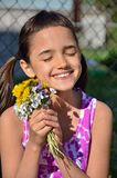 Smiling Girl with Bouquet of Flowers Royalty Free Stock Photos