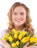 Smiling girl with a bouquet Royalty Free Stock Images