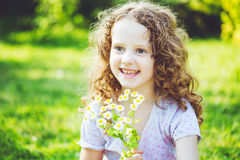 Smiling girl with a bouquet of white daisy. Mothers day concept. Background toned in instagram filter Stock Photo