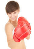Smiling girl with boxing gloves Stock Photos