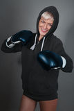 Smiling girl in boxing gloves Royalty Free Stock Photos