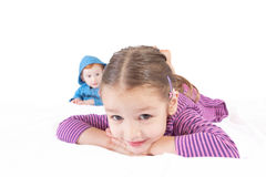 Smiling girl and boy kids lying stock photos