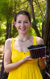 Smiling girl with boysenberries Stock Images