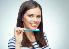 Smiling girl with brace brushing teeth. Royalty Free Stock Image