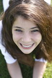 Smiling girl with braces. Close up of smiling pretty teenage girl with metal dental braces view from the top Royalty Free Stock Photos