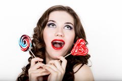 Smiling girl with braces holding heart candy posing on a white background Stock Photography