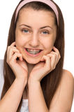 Smiling girl with braces isolated Stock Image