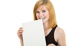 Smiling girl with brackets and white billboard Royalty Free Stock Photo