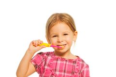 Smiling girl brush teeth Stock Images