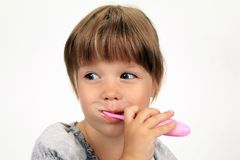 The smiling girl brushes teeth Royalty Free Stock Images