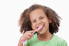 Smiling girl brushing her teeth Royalty Free Stock Photography