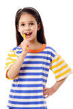 Smiling girl brushing teeth Stock Photography