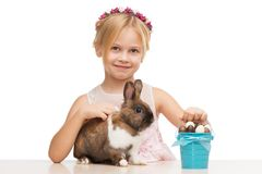 Smiling girl with bunny and chocolate eggs Royalty Free Stock Photo