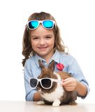 Smiling girl and bunny in sunglasses Royalty Free Stock Photos