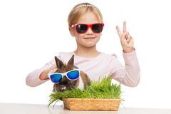 Smiling girl and bunny in sunglasses Royalty Free Stock Images