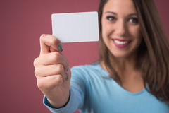 Smiling girl with business card Royalty Free Stock Photos