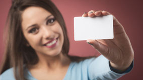 Smiling girl with business card Royalty Free Stock Image