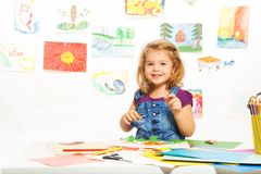 Smiling girl busy gluing Royalty Free Stock Image