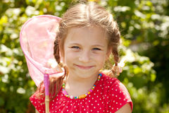 Smiling girl with a butterfly net Stock Photography