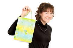 Smiling girl buyer with present bag Royalty Free Stock Photos