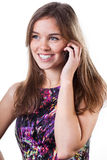 Smiling girl calling by mobile phone Stock Photo