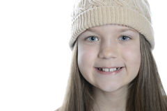 Smiling girl in cap royalty free stock photography