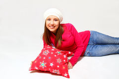 Smiling girl with a cap and a pillow lying  Stock Photography