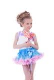 Smiling girl with caramel posing in studio royalty free stock photos