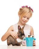 Smiling girl caressing little bunny Royalty Free Stock Photo