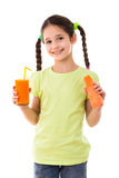 Smiling girl with carrot and glass of juice Royalty Free Stock Photography