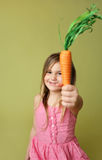 Smiling Girl with Carrot Stock Photography