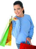 Smiling Girl Carry Shopping Bags. Beautiful young woman carrying shopping bags. isolated stock photo