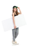 Smiling girl carrying blank placard. Royalty Free Stock Photography