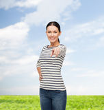Smiling girl in casual clother pointing at you Royalty Free Stock Photos