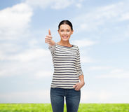 Smiling girl in casual clother showing thumbs up Royalty Free Stock Photo