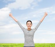 Smiling girl in casual clother showing thumbs up Stock Photography