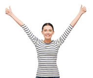 Smiling girl in casual clother showing thumbs up Stock Image