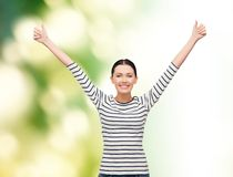 Smiling girl in casual clother showing thumbs up Stock Photo